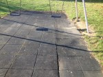 black play tiles underneath set of swings